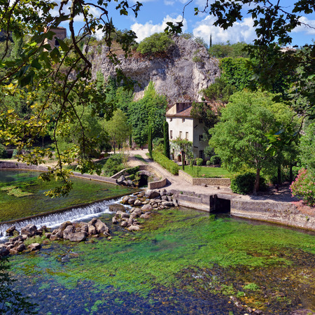 vaucluse: Beautiful Medieval Village Fontaine de Vaucluse on the river shore Provence France.The poet Petrarch made it his preferred residence in the 14th century