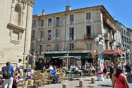 AVIGNON FRANCE JUL December 2014: Street scene in historical centre of Avignon. Avignon is a famous and very popular among tourists city in Provence in south of France.
