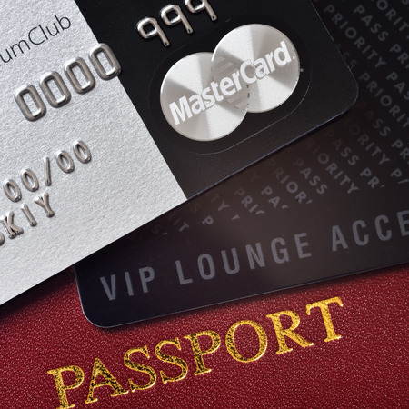 ides: RUSSIA MOSCOW FEB 22 2015: Premium credit card MasterCard Black Edition Priority Pass card card for VIP lounge access and international passport. White background. VIP travel concept Editorial