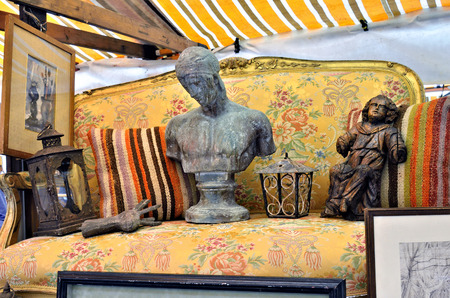 VENICE ITALY SEP 21 2014: Old torches painting sculpture furniture arts etc for sale at Venice Campo San Maurizio flea market. This flea market serves the professional antique dealers.