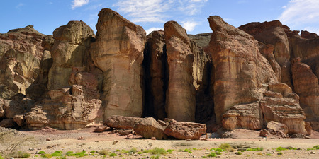 penetrated: Solomons Pillars Timna park Israel. The pillars were formed over 500 million years ago by rain penetrated into fissures in the sandstone