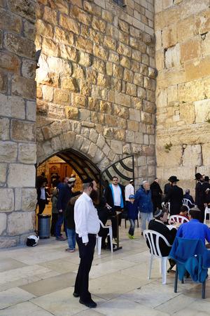 worshipers: JERUSALEM, ISRAEL - MARCH 29, 2015: Jewish worshipers pray at Wailing Wall in Jerusalem after sunset, Israel Editorial