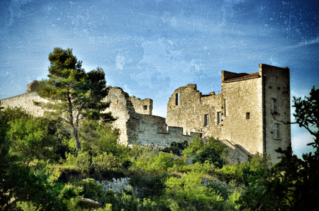luberon: Ruined castle of the Marquis de Sade in village Lacoste, Provence, France. Filtered image, vintage effect applied grunge, tone and blur