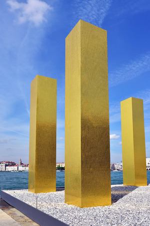 mack: VENICE, ITALY - SEP 24, 2014: The installation The Sky Over Nine Columns of sculptor Heinz Mack in San Giorgio Maggiore.  Modern art sculpture at island San Giorgio Maggiore in Venice, Italy