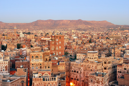 mud wall: Yemen. Sunrise in the old city of Sanaa. Inhabited for more than 2.500 years at an altitude of 2.200 m, the Old City of Sanaa is a UNESCO World Heritage City now destroyed by the civil war Editorial