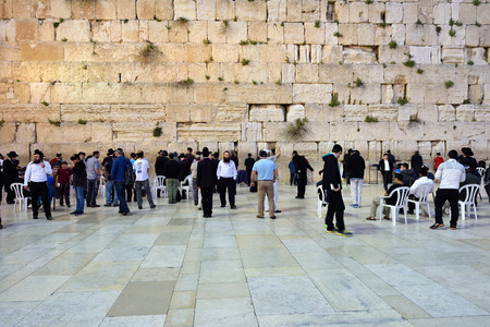 wailing: ERUSALEM, ISRAEL - MARCH 29, 2015: Jewish worshipers pray at Wailing Wall in Jerusalem, Israel