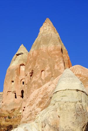 dwelling: Rocks with dwelling cave standing in Cappadocia, Turkey