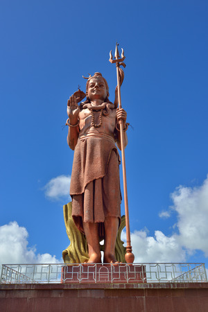 MAURITIUS - MAY 01, 2013: Shiva statue at Grand Bassin temple - most important hindu temples of Mauritius. It is 33 meters tall and is known as the highest statue in Mauritius Editorial