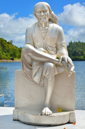 turism: MAURITIUS - MAY 01, 2013:  Monk statue in Grand Bassin - hindu temples of Mauritius. Grand Bassin is a sacred crater lake is one of the most important hindu pilgrimage sites outside of India