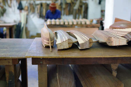 pez vela: An unidentified person makes a ship model in factory in Mauritius. Wooden replica of old famous sailfish is the most popular tourist souvenir at island of Mauritius