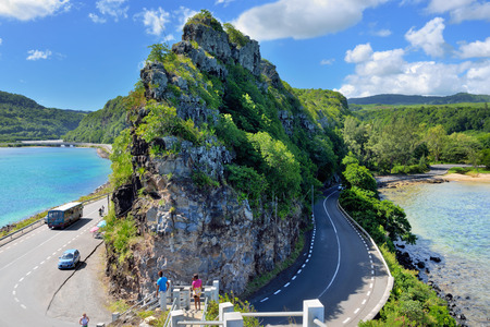 preferable: MAURITIUS - APR 28, 2013: Road around the high cliff on the coast of Indian ocean. Mauritius island is one from preferable destination for luxury holiday in all season Mauritius