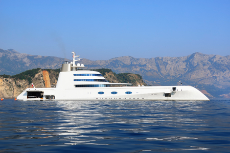 super yacht: BUDVA, MONTENEGRO - AUG 02, 2009: Luxury yacht A, owned by Russian billionaire A.Melnichenko is shown on in the gulf of Budva. The vessel is 118 m long, has 6 guest suites and accommodations for 42 staff