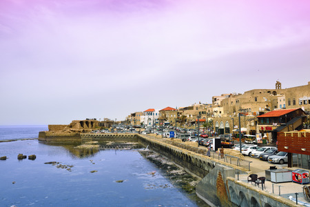 acre: ACRE, ISRAEL - MARCH 28, 2015: View at marina and old town of Acre at twilight time. Acre Akko, one of the major tourist attraction of northern Israel