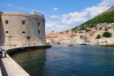 former yugoslavia: DUBROVNIK, CROATIA - AUG 06, 2009: View on the fortress and marina in the old town of Dubrovnik, Croatia. Dubrovnik is a UNESCO World Heritage site