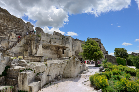 relying: LES BAUX, FRANCE - JUL 9, 2014: Castle les Baux. Les Baux is now given over entirely to the tourist trade, relying on a reputation as one of the most picturesque villages in France