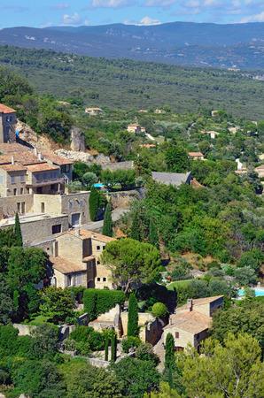 gordes: Beautiful Medieval Village of Gordes and rural landscape, Provence, France Stock Photo