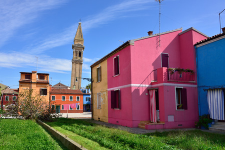 veneto: Courtyard between colorful houses at Burano island, Venice, landmark of Veneto region, Italy Editorial