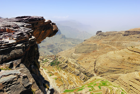 brink: An edge of the cliff hungs over abyss 800 meter deep.  Plateau Bokur, Yemen