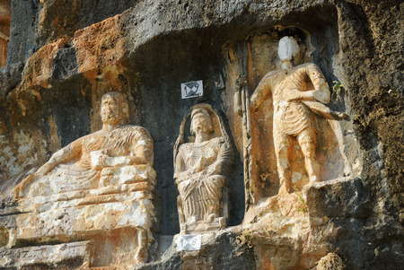 literally: Adamkayalar - literally man-rocks is a location in Mersin Province, Turkey famous for rock carved figures. These figures are probably from the second century AD Stock Photo