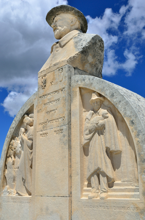 bard: LEX BAUX DE PROVENCE, FRANCE - JUL 9, 2014: Monument of Charloun dou Paradou, famous Provencal bard. He is considered to be one Pronounces most authentic poetic voices. Sculptor Botinelly, 1930 Editorial
