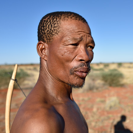 KALAHARI NAMIBIA - JAN 24, 2016: Close-up portrait hunter Bushman. The San people, also known as Bushmen are members of various indigenous hunter-gatherer peoples of Southern Africa
