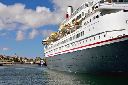 luderitz: LUDERITZ, NAMIBIA - JAN 27, 2016: Big cruise ship shown in the port of Luderitz in the early morning. Luderitz is popular destination a many of cruise lines Editorial