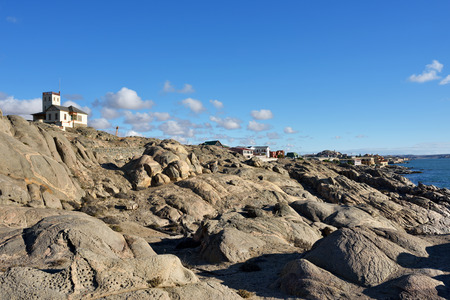luderitz: Rocky shore of the Atlantic Ocean in the region of Luderitz, Namibia. Warm evening light Stock Photo