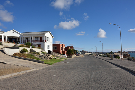 luderitz: LUDERITZ, NAMIBIA - JAN 26, 2016: Seafront of the Luderitz in Shark island. Luderitz is a harbour town in southwest Namibia, lying on one of the least hospitable coasts in Africa Editorial