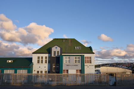 luderitz: LUDERITZ, NAMIBIA - JAN 26, 2016: Marine research institute of ministry of fisheries in Luderitz shown at sunset, Luderitz is a harbour town in southwest Namibia