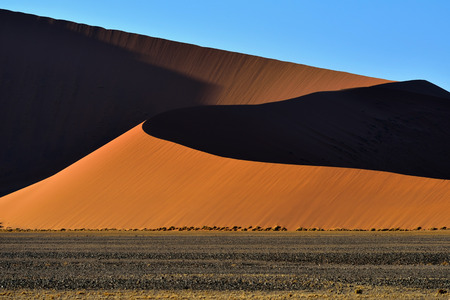 namib: Beautiful landscape with big orange dunes at sunrise, Sossusvlei, Namib Naukluft National Park, Namib desert, Namibia Stock Photo
