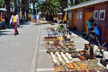 swakopmund: SWAKOPMUND, NAMIBIA - JAN 31, 2016: Local sellers shown on the craft market in Swakopmund. Local hand made toys and other african goods very popular between tourists