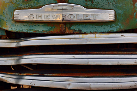 old service station: SOLITAIRE, NAMIBIA - JAN 30, 2016: Car grille of the abandoned old Chevrolet car at the service station at Solitaire in the Namib Desert, Namibia. Popular touristic destination Editorial