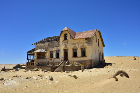 kolmanskop: The abandoned ghost diamond town of Kolmanskop in Namibia, which is slowly being swallowed by the desert