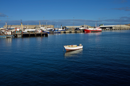 luderitz: LUDERITZ, NAMIBIA - JAN 26, 2016: Small boat in port of Luderitz, Luderitz is a harbour town in southwest Namibia, lying on one of the least hospitable coasts in Africa