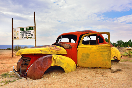 abandoned car: SOLITAIRE, NAMIBIA - JAN 30, 2016: Damaged abandoned old Hudson car at the service station at Solitaire in the Namib Desert, Namibia. Popular touristic destination Editorial