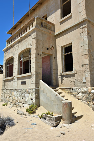kolmannskuppe: The abandoned ghost diamond town of Kolmanskop in Namibia, which is slowly being swallowed by the desert