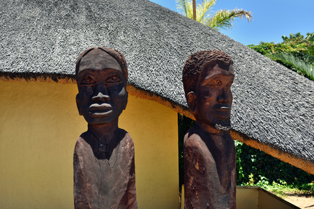 frans: WATERBERG, NAMIBIA - FEB 04, 2016:Two wooden carved figure in Frans Indongo Lodge, one from the most popular place in Waterberg region to stay and relax during safari