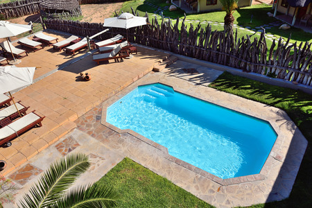 frans: WATERBERG, NAMIBIA - FEB 04, 2016: Swimming pool in Frans Indongo Lodge, one from the most famous and popular place in Waterberg region to stay and relax during safari