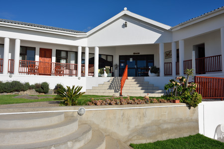 luderitz: LUDERITZ, NAMIBIA - JAN 31, 2016: Kairos Cottage Lodge on the atlantic ocean coast, the most popular place to stay and relax during visit Luderitz Editorial