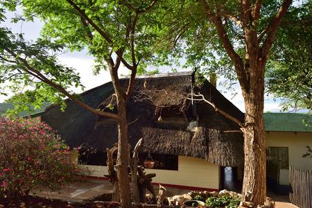 unspoilt: DAMARALAND, NAMIBIA - FEB 04, 2016:  Accommodation units in in Toko Lodge at sunrise. Toko is the gateway to Western Etosha, Damaraland and the unspoilt Kaokoveld