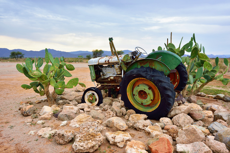 old service station: SOLITAIRE, NAMIBIA - JAN 30, 2016: Damaged abandoned old Fordson tractor at the service station at Solitaire in the Namib Desert, Namibia. Popular touristic destination