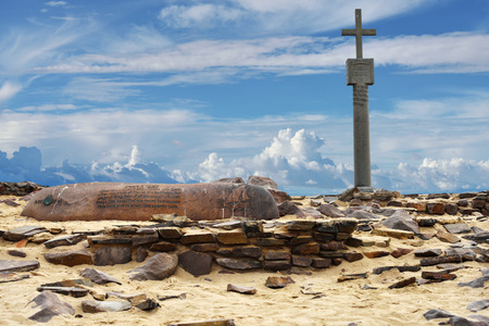 memorial cross: CAPE CROSS, NAMIBIA - JAN 31, 2016: A memorial stone for Diogo Cao who landed at this spot in 1485 and who erected a stone cross or padrao at this spot