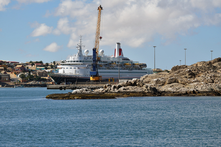 luderitz: LUDERITZ, NAMIBIA - JAN 27, 2016: Big cruise ship Fred Olson cruise lines Boudicca shown in the port of Luderitz. Luderitz is popular destination for a many of cruise lines