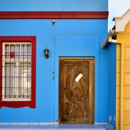 20th century: Architecture detail. Door and window of the historical building built in the early 20th century in Luderitz