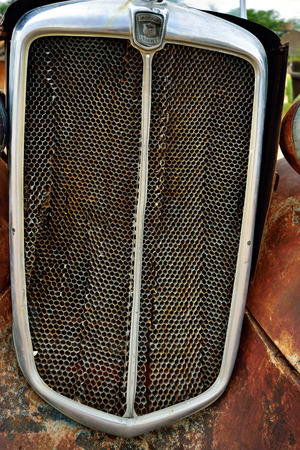 corroding: SOLITAIRE, NAMIBIA - JAN 30, 2016: Grill of the old Morris Eight car at the service station at Solitaire in the Namib Desert, Namibia. Popular touristic destination Editorial