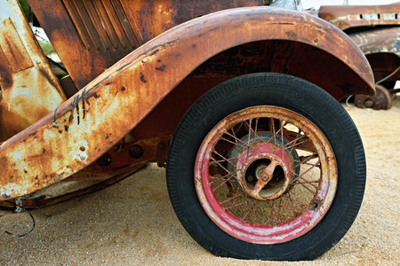 morris: SOLITAIRE, NAMIBIA - JAN 30, 2016: Detail of abandoned old Morris Eight car at the service station at Solitaire in the Namib Desert, Namibia. Popular touristic destination Editorial
