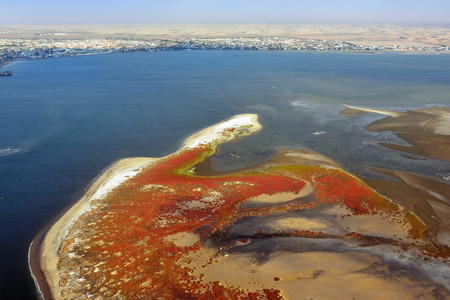 sandbank: Aerial view on the sandbank in the Atlantic ocean near a coast in Namibia and modern district of the city Walvis Bay on background, Africa