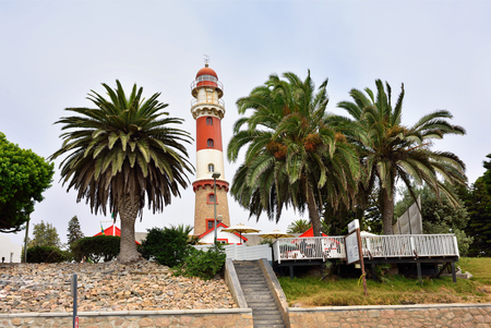 swakopmund: SWAKOPMUND, NAMIBIA - JAN 31, 2016: Lighthouse in Swakopmund. City was founded in 1892, by Captain Curt von Francois as the main harbour of German South West Africa Editorial