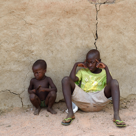northern african: KAMANJAB, NAMIBIA - FEB 1, 2016: Little unidentified Himba children shown in himba tribe village