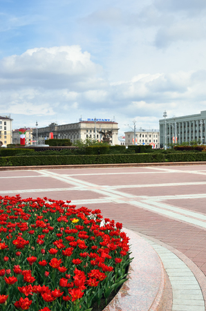 day flowering: MINSK, BELARUS - JULY 30, 2015: Central part of Minsk at spring day, flowering tulips in flowerbed at square Editorial